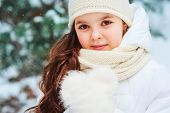 Winter Close Up Portrait Of Cute Dreamy Child Girl In White Coat, Hat And Mittens Playing Outdoor In poster