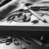 Old Tools At Table. Pieces Of Leather At Cobbler Workplace. Shoemakers Work Desk. Leather Craft Too poster