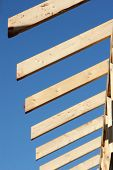 The ends of wooden rafters on a new home or building. *Shallow Depth of Field*