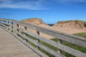 A boardwalk over the sand dunes to the beach in Cavendish National Park, Prince Edward Island, Canada