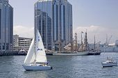 HALIFAX, NOVA SCOTIA - JUNE 20: Sailboats sail along the Halifax waterfront the Nova Scotia Tall Shi