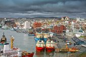 Storm clouds form over the city of St. John's and St. John's busy harbour.