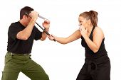 stock photo of truncheon  - Man and woman practice fight using knife and truncheon - JPG
