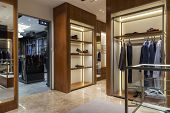 clothing store interior with wooden shelves for clothes poster