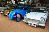 CHENNAI - INDIA - JULY 24: Fiat 500 and Triumph Herald 1966 (retro vintage cars) on Heritage Car Rally 2011 of Madras Heritage Motoring Club at Egmore on July 24, 2011 in Chennai, India