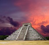 stock photo of mayan  - Mayan pyramid of Kukulcan El Castillo on sunset - JPG