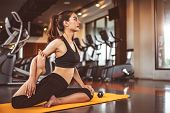 Woman Doing Bending Legs Yoga In Fitness Workouts Training Gym Center Background. Lifestyle Woman Si poster