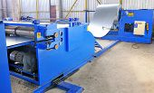 machine for rolling steel sheet in warehouse