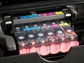 close-up shot of a CMYK ink cartridges for a color printer