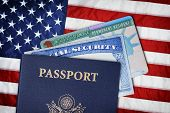 United States Passport, Social Security Card And Resident Card Over American Flag. Immigration Conce poster