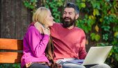 Couple In Love Notebook Consume Content. Surfing Internet Together. Couple With Laptop Sit Bench In  poster