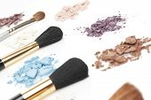colorful eyeshadow and thick cosmetic brushes