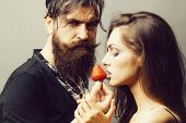 Young Sexy Couple Of Woman With Pretty Face And Brunette Hair With Bare Shoulders And Handsome Beard poster