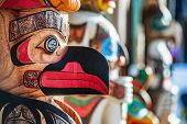 Alaska totem pole carving art sculture store in tourist travel attraction town on Alaska cruise. Ket poster