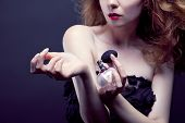 stock photo of perfume  - beautiful woman applying perfume on her body - JPG