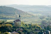 An Old Baroque Countryside Church From Above - Autumn Countryside Landscape poster