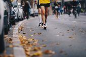 Marathon Running Race, People Feet On Autumn Road. Runners Run Urban Marathon In The The City. Group poster