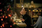 Woman Enjoy Wine In Restaurant. Girl With Long Hair Celebrate New Year And Christmas. Festive Fashio poster