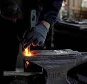 picture of blacksmith shop  - Blacksmith forges a red - JPG