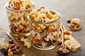 Homemade Halloween Trail Mix With Candy Corn, Popcorn And Pretzels poster