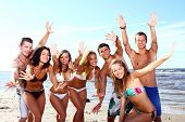 picture of beach party  - happy teenagers playing in the sea - JPG