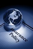 stock photo of insurance-policy  - Globe and Insurance Policy concept of Global Business - JPG