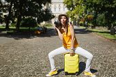 Amazed Funny Traveler Tourist Woman In Casual Clothes, Hat Sitting On Suitcase With Retro Vintage Ph poster