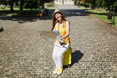 Laughing Traveler Tourist Woman In Yellow Clothes Hat Sitting On Suitcase Holding City Map Search Ro poster