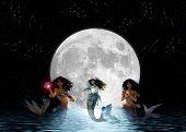 Mermaids Swimming In The Moonlight.