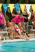 Child Swimmer Dives Into Pool In Swim Meet