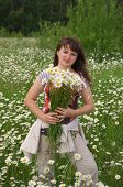 Woman with daisywheel bouquet