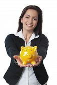 Asian Businesswoman Presenting Piggy Bank