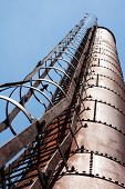 Industrial Factory Chimney Against Blue Sky