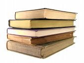 stock photo of illiteracy  - Stack of old vintage books isolated on white  - JPG