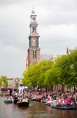 AMSTERDAM, THE NETHERLANDS - AUGUST 4: Participants dance in front of spectators at the famous Canal
