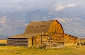stock photo of rockefeller  - John Moulton Barn and Grand Teton range at sunrise - JPG