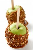 caramel apple, taffy apple, candy apple, toffee apple, with almonds