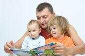 foto of fairy-tale  - young father reading fairy tale to children - JPG