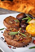 delicious grilled steak with vegetable on wooden table