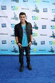 Los Angeles - AUG 19:  Adam Irigoyen arrives at the 2012 Do Something Awards at Barker Hanger on Aug