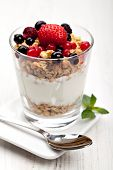 image of cobnuts  - yogurt with muesli and berries in small glass - JPG