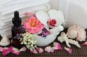 Spa and aromatherapy accessories with orchid, rose, elderflower, spirea and lavender herb flower blossom.