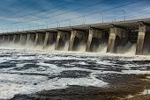 Water Pouring Through Sleus Gates At Dam
