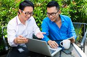 image of internet-cafe  - Asian Businesspeople working outdoor  - JPG