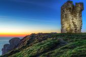 stock photo of cliffs moher  - Ruins of old castle on Cliffs of Moher at dusk - JPG