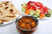 image of kadai  - Kadai paneer cheese curry in a cardamon gravy with naan bread and salad - JPG