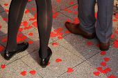 Couple Standing On Rose Petals