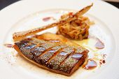 Seabass cooked in asian style with teriyaki sauce
