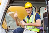stock photo of heavy equipment operator  - earthmover operator giving thumb up on construction site - JPG