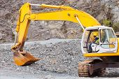 african road construction worker operating excavator on construction site